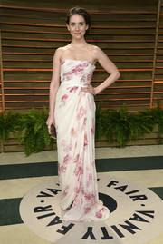 Alison Brie oozed sweetness in a white and pink floral strapless gown by Giambattista Valli during the Vanity Fair Oscar party.