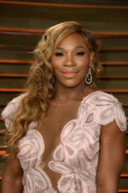 Serena Williams was all dolled up with ultra-feminine curls at the Vanity Fair Oscar party.
