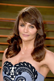 Helena Christensen sported a lovely wavy 'do with feathered bangs during the Vanity Fair Oscar party.