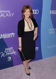 Anne Sweeney complemented her two-tone dress with a black shrug sweater when she attended the Variety Power of Women event.