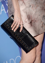 Darby Stanchfield accessorized with an edgy-chic studded black clutch at the Variety Power of Women event.