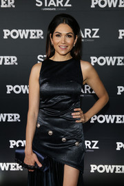 Lela Loren accessorized with a luxurious navy satin clutch at the 'Power' season 4 premiere.
