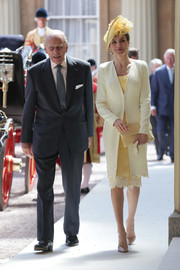 Queen Letizia of Spain polished off her monochromatic look with a yellow suede clutch by Magrit.