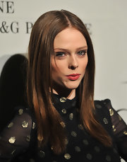 Coco Rocha wore her long tresses sleek and straight with a precise center part at The Ever Changing Face of Beauty party.