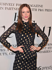 Coco Rocha attended The Ever Changing Face of Beauty party wearing classic red nail polish.
