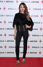Chrissy Teigen sheathed her long, slim legs in a pair of high-waisted, front-button skinnies by Balmain.