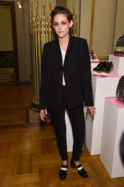 Kristen Stewart sealed off her look with a pair of black-and-white faux-patent loafers, also by Stella McCartney.
