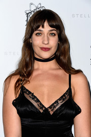 Lola Kirke styled her hair with just a hint of a wave for the Stella McCartney presentation.