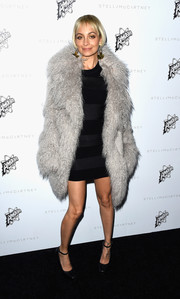 Nicole Richie brought the glamour when she wore a black minidress under an oversized grey fuzzy coat.