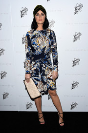 Katy Perry wore a mixture of prints on her long-sleeved dress that she accessorized with a velvet green hair wrap.