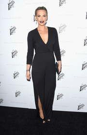 Molly Sims had a vampy look with her dark purple lipstick and plunging V-neck gown.
