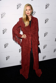 Rachel Zoe wore a suede red coat that featured fringe details on the sleeves for an urban look.