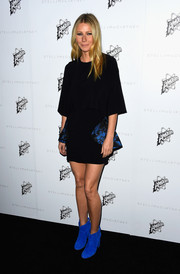 Gwyneth Paltrow rocked an above-the-knee black minidress that she paired with blue suede ankle boots for an eclectic look.