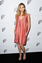 Elizabeth Olsen donned a light pink and orange shift dress that she wore with strappy sandals for a casual vibe.