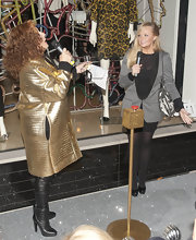 Jennifer Saunders' black mid-calf boots looked oh-so-stylish with her gold jacket.