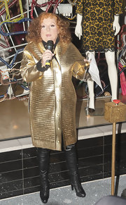 Jennifer Saunders was all dressed up for the holidays in a textured metallic gold coat.