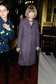 Anna Wintour looked classic as ever at the Stella McCartney runway show in Paris, where she wore a pink and black checkered wool coat.
