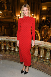 Karlie Kloss showed off her slim figure in a body-con red logo dress by Stella McCartney during the brand's Fall 2019 show.