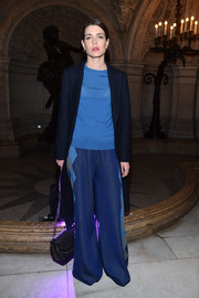 Charlotte Casiraghi accessorized her look with an elegant black chain-strap bag.
