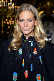 Poppy Delevingne wore her wavy locks loose with a center part during the Stella McCartney fashion show.