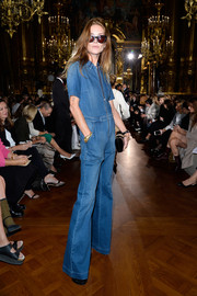Erin Wasson got into a '70s mood with this flared denim jumpsuit at the Stella McCartney fashion show.