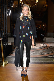 Poppy Delevingne arrived for the Stella McCartney fashion show wearing a black boyfriend blazer over a print blouse.