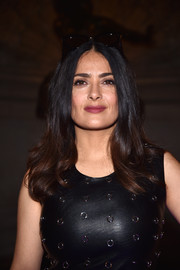 Salma Hayek styled her hair with wavy ends for the Stella McCartney fashion show.