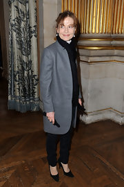 Isabelle Huppert sported a menswear-inspired look at the Stella McCartney fashion show with a gray wool coat and black slacks.