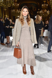 Miroslava Duma looked totally ready for fall in a taupe turtleneck sweater dress during the Stella McCartney fashion show.