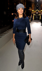 Salma completed her navy skirt suit with over-the-knee leather boots.
