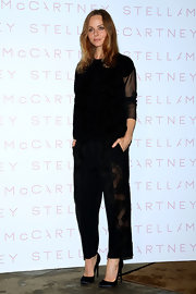 To keep her look cool and sophisticated, Stella McCartney rocked a pair of black lace mesh pants.