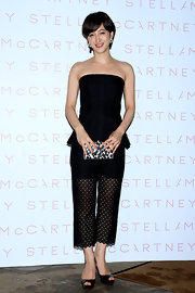 A pair of lace cutout capris topped off Christel Takigawa's look at the Stella McCartney cocktail party.