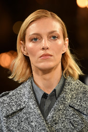 Anja Rubik walked the Stella McCartney runway wearing a casual side-parted hairstyle.