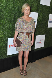 Kathleen Robertson added a touch of hippie style to her sequined dress when she paired it with a cool leather belt and platform sandals.