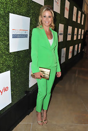 Julie Bowen opted for a classic pantsuit in a modern and bright neon green shade!