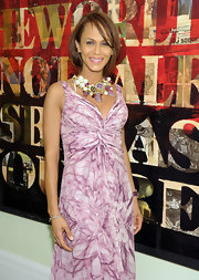 Actress Nicole Kodjoe showed off her lilac printed dress while attending an event in New York. Her gemstone statement necklace was the standout piece, however.