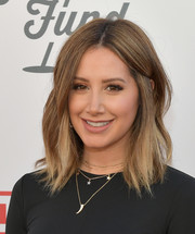 Ashley Tisdale adorned her black look with layers of gold necklaces.