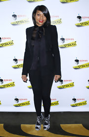Taraji P. Henson attempted to add polish to her eccentric ensemble with a black boyfriend blazer at the after party for 'Stick Fly.'