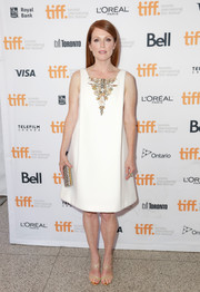 Julianne Moore complemented her LWD with a beaded clutch.