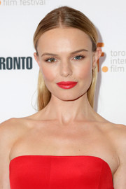 Kate Bosworth matched her outfit with a bold red lip.