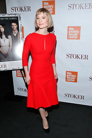 Mia Wasikowska opted for a classic look at the 'Stoker' NYC screening with a red dress with keyhole neck and feminine pleating.