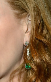 Nicole Kidman accessorized her look with diamond and emerald earrings.