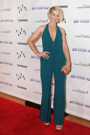 Jenna Elfman chose a teal halter jumpsuit for an effortlessly sophisticated red carpet look during the 'Big Stone Gap' premiere.