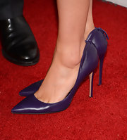 Clare Grant's eggplant pumps with stitching on the heel added just a touch of color to her white frock.