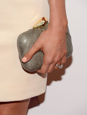 Clare Grant chose this snakeskin clutch with a gold knob opening to pair with her cream red-carpet dress.