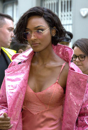 Jourdan Dunn sported pink sunglasses to match her coat and slip dress while headed to the Burberry show.
