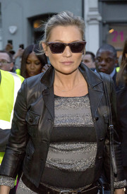 Kate Moss headed to the Burberry show looking rocker-chic in a black leather jacket.