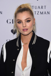 Rachel Hilbert attended the launch of the Stuart Weitzman Gigi boot sporting a tight ponytail.