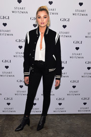 Rachel Hilbert was sporty in a black-and-white Saint Laurent track jacket at the launch of the Stuart Weitzman Gigi boot.