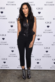 Padma Lakshmi was biker-chic in a black leather vest at the launch of the Stuart Weitzman Gigi boot.